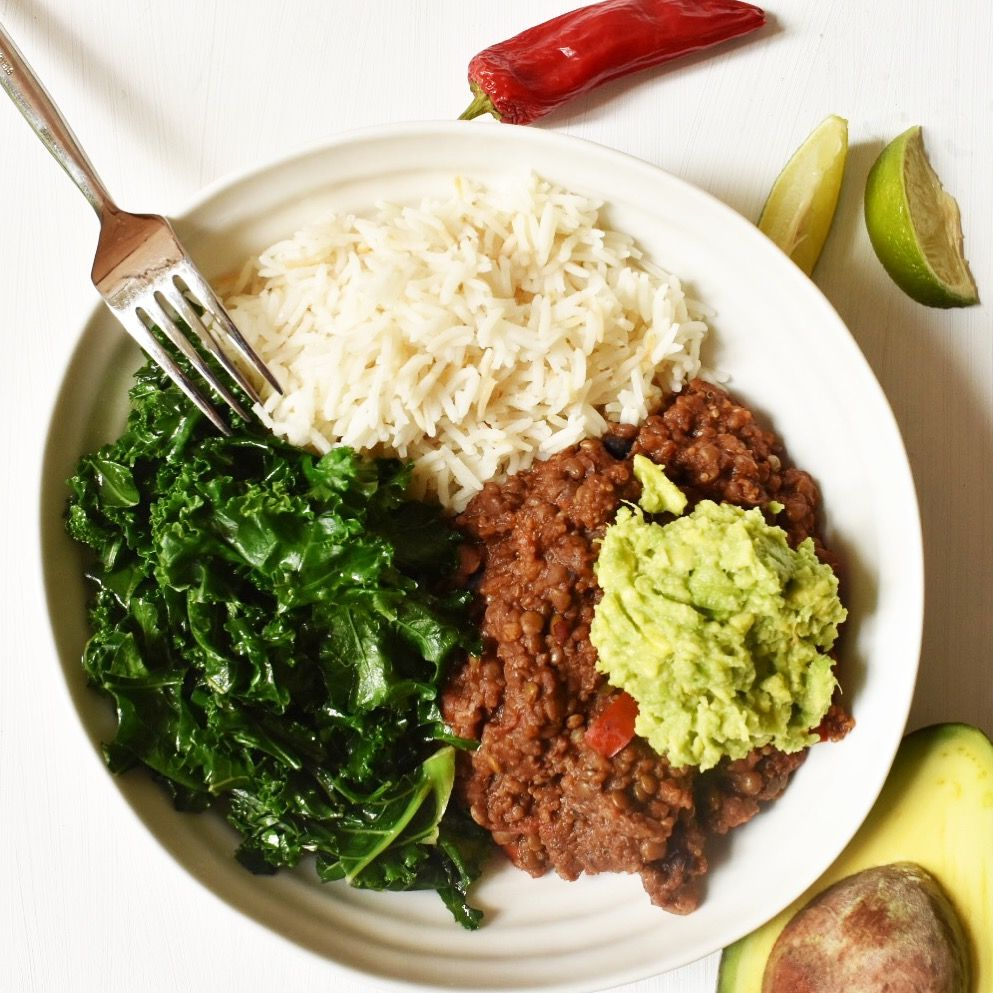 Vegan chilli with kale, rice, and guacamole