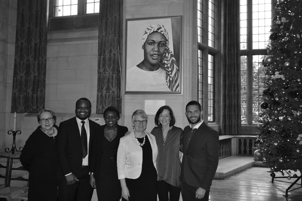 Dr. Olivarius at the unveiling the first portrait of a female Rhodes Scholar, Lucy Banda-Sichone, a Zambian human rights activist, painted by famed Washington D.C. artist Deirdre Saunders. The Rhodes Project and Rhodes Trust commissioned the painting. The portrait was made possible by Olivarius and fellow Rhodes Scholars Tony Abrahams (CEO of Ai-Media) Charles Conn (Warden of Rhodes House) and Dominic Barton (Worldwide Managing Director of McKinsey & Co.) From left to right: Olivarius; Zambian Rhodes scholars Kabeleka Kabeleka and Karen Mumba; Rhodes Project Executive Director Dr. Susan Rudy; Deirdre Saunders; Tony Abrahams.