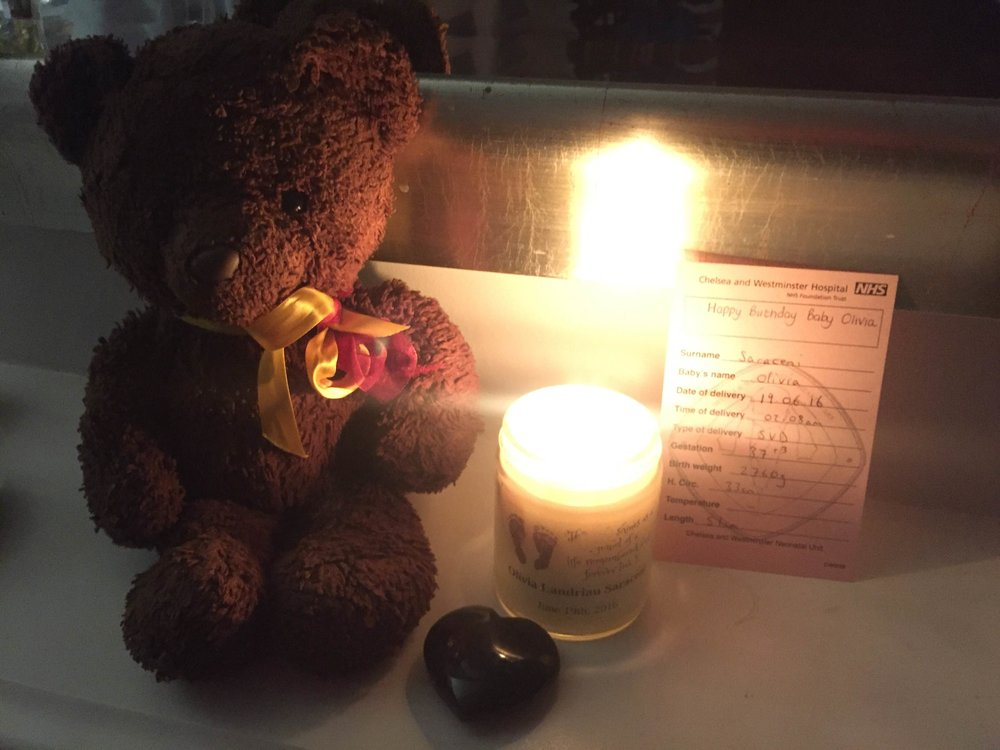 Osi, Olivia's faithful companion and the candle specially made for her by Tía Titi