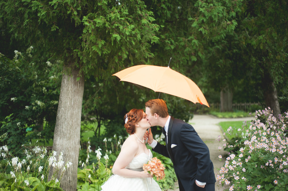 rainy day wedding - bride and groom - umbrella on wedding day - bride and groom - Riverside Reception Wedding - Fabyan Forest Preserve Wedding - Penrose Brewing Wedding - fall - Geneva Illinois.jpg