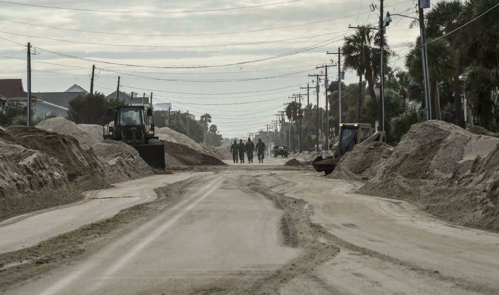 The National Guard assessing damage on Edisto Beach after Hurricane Matthew in 2016. Believe it or not, this used to be the main street. Photo Credit: USDA