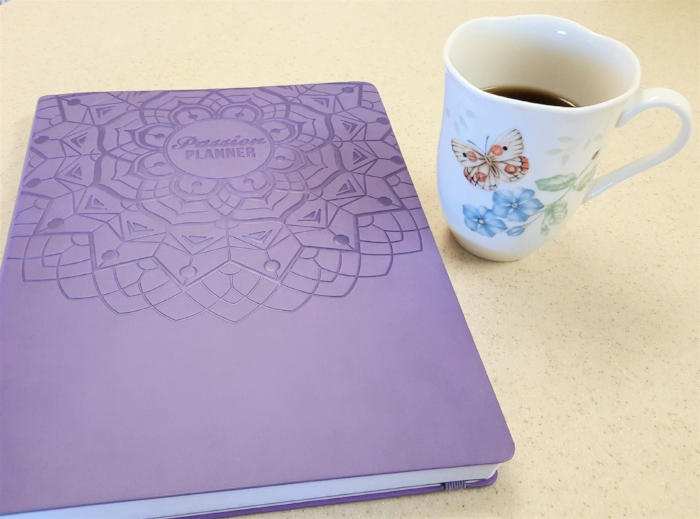 Here's how my workdays start. I pour myself a hot beverage, and I assess my plan. (I used the black Passion Planner my first year, but this year I went with the purple one. The layout is the same.)