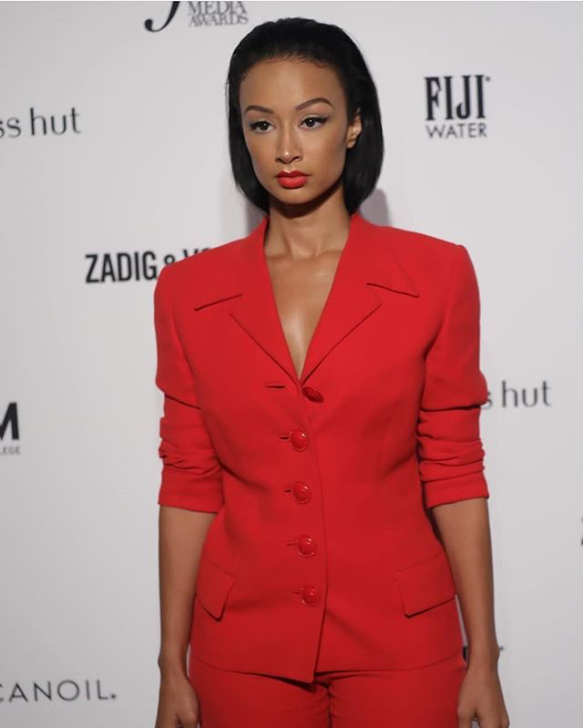 Draya Michele Attends The Fashion Media Awards In A Versace Suit