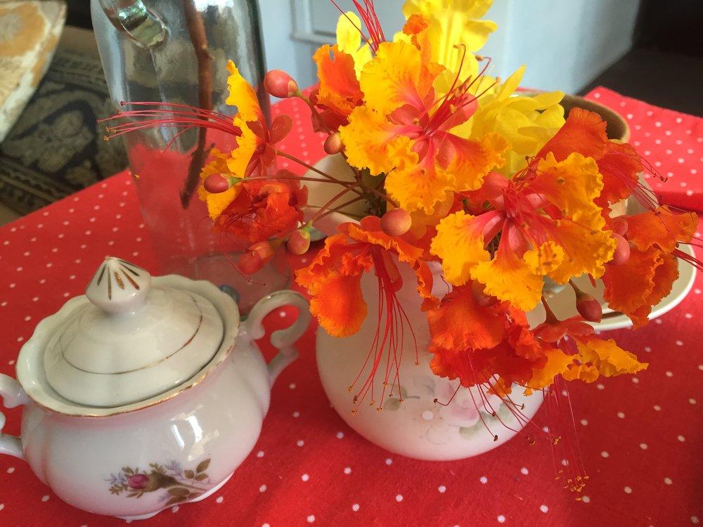 Pride of Barbados Flowers in creamer and sugar bowl