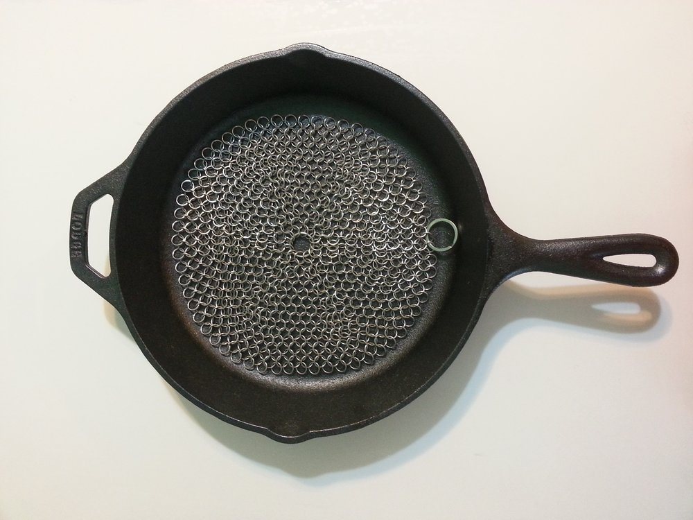 I use this    cast iron scrubber    everyday! I love that it doesn't rust or scratch my seasoning.