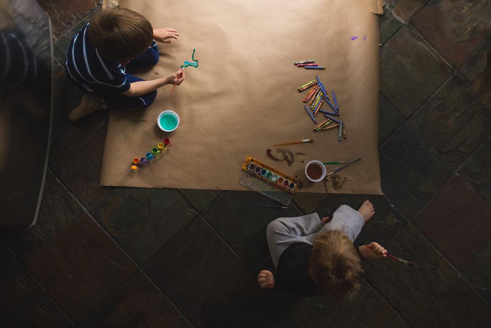 Boys coloring on big paper at slider (365).jpg