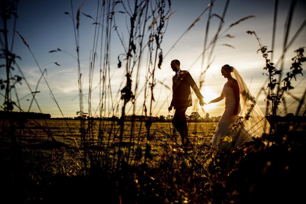 wedding couple walking during sunset