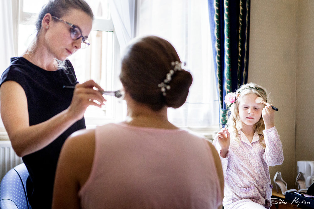 bride getting ready with her daughter