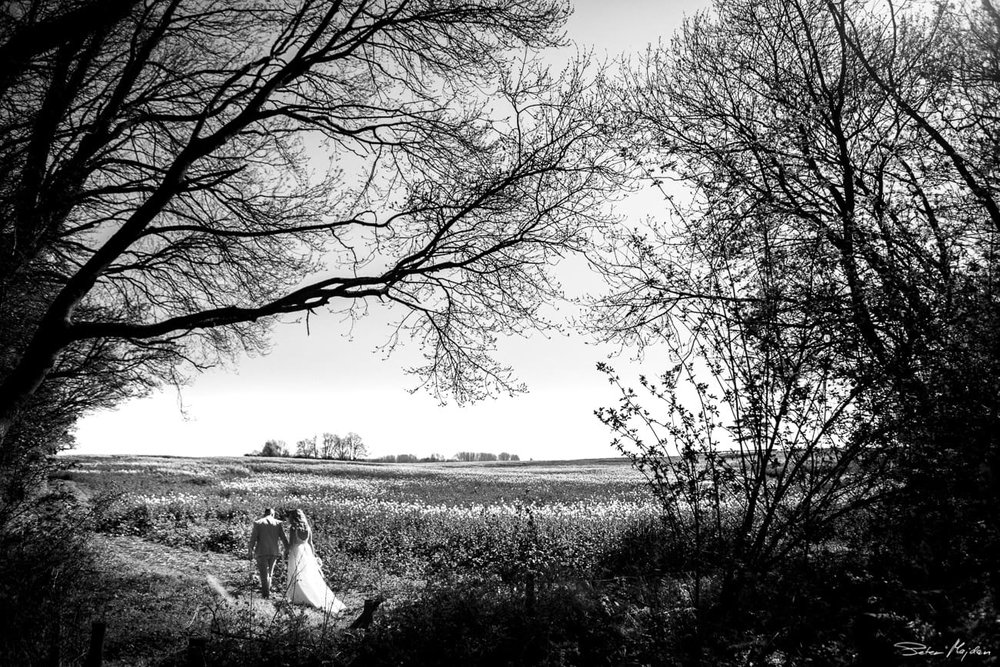 bride and groom walking outside
