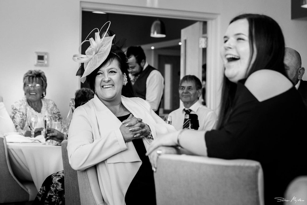 wedding guests laughing at woodlands