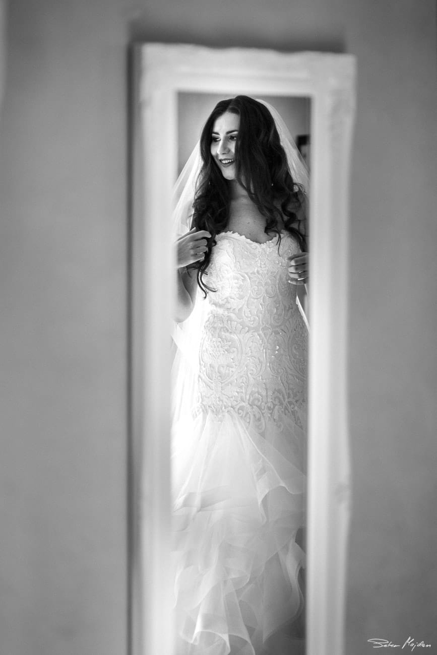 brides reflection in the mirror