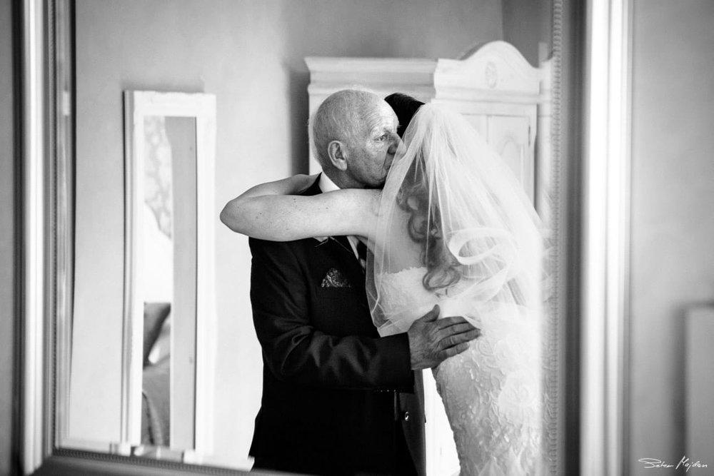 grandfather hugging bride