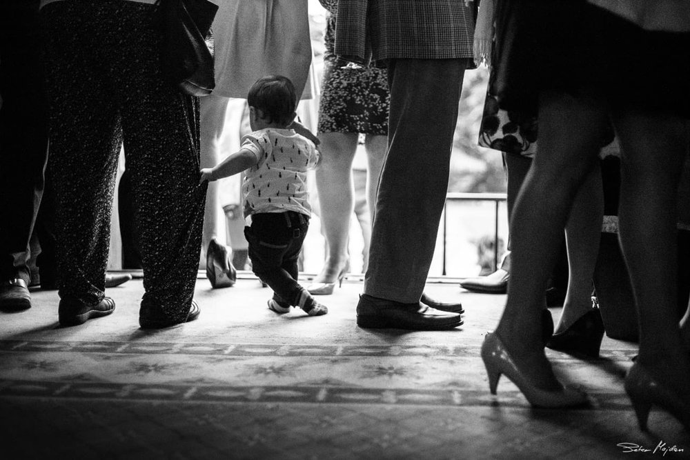 kid walking among wedding guests