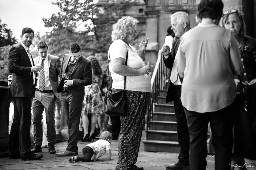 wedding guests outside wollaton hall