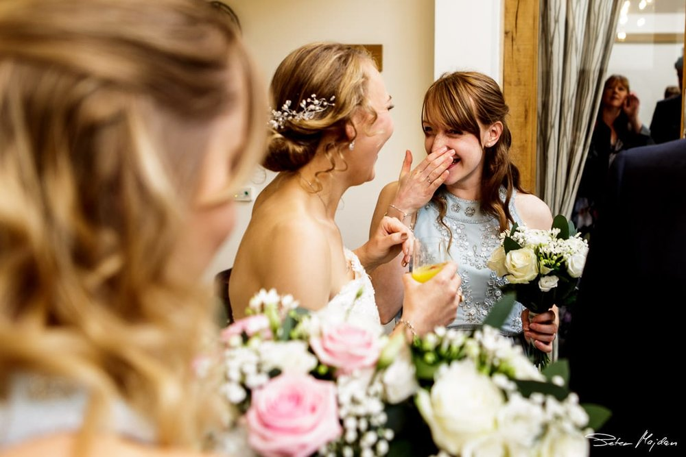 wedding guest laughing at mythe barn