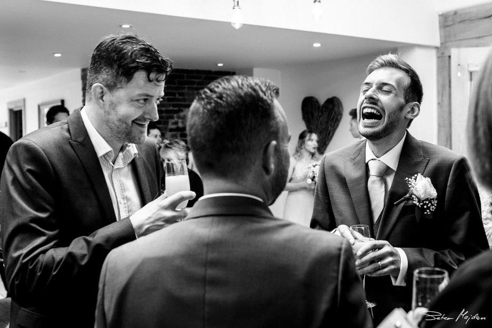 groom and best men having fun