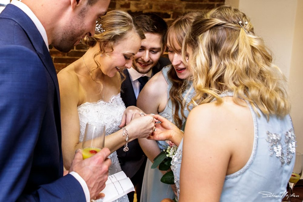 bride showing her wedding ring
