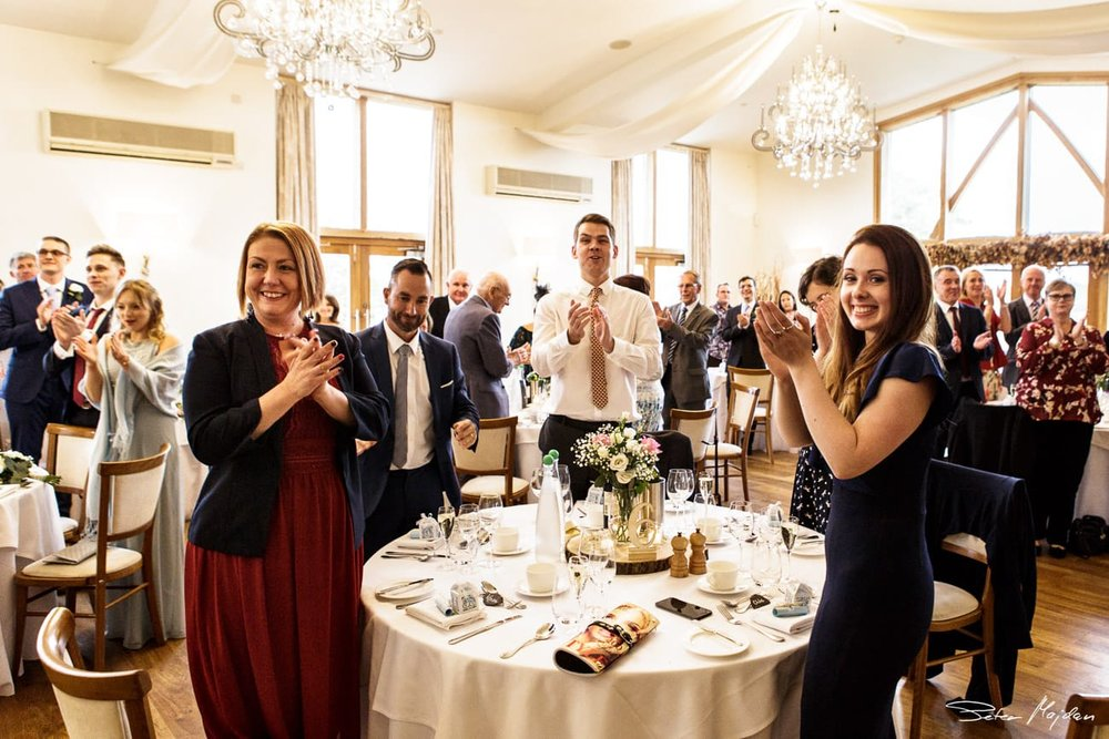 guests welcoming wedding couple