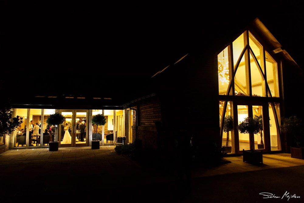 night time photo of oak barn