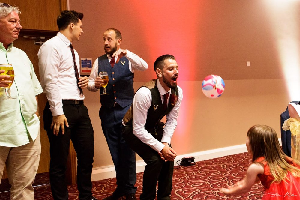 groom playing with kids