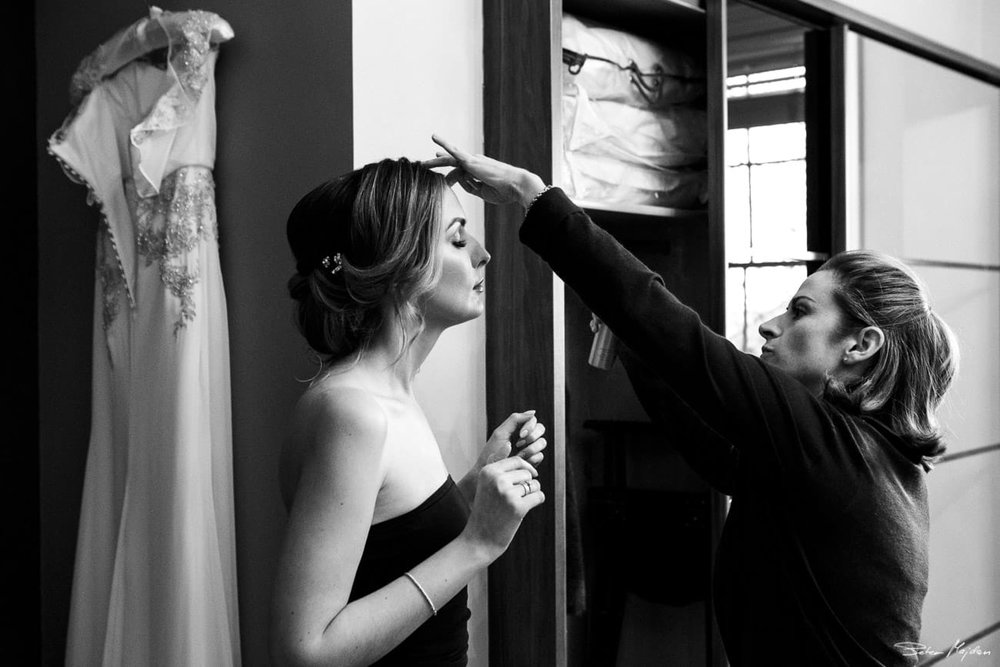 finishing touches for bride