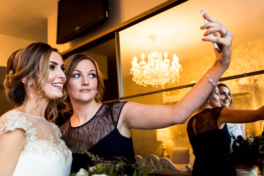 bride and her sister doing selfie