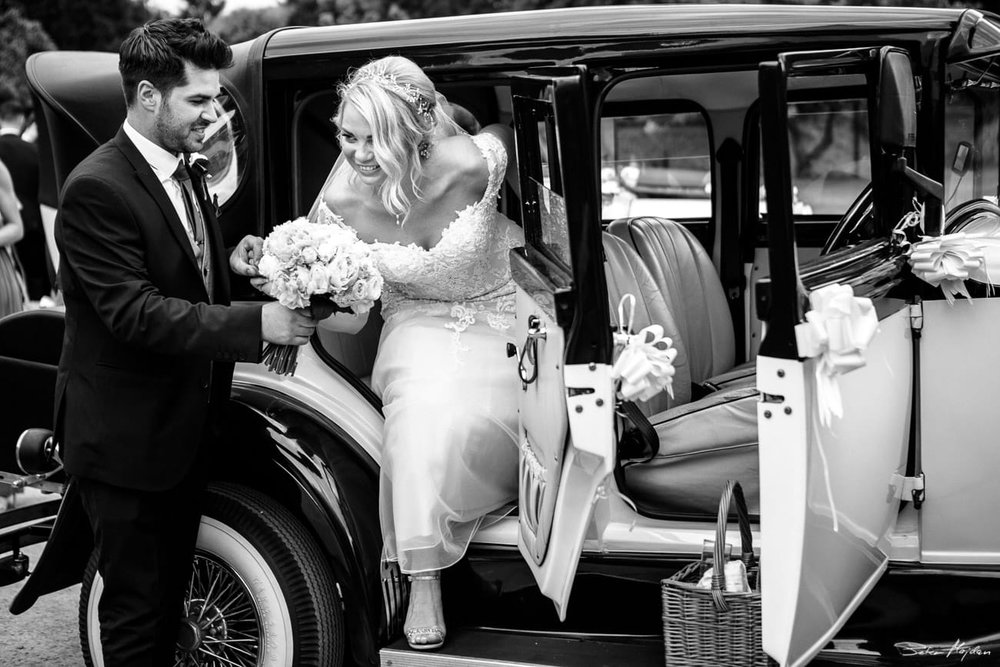bride arriving in vintage car