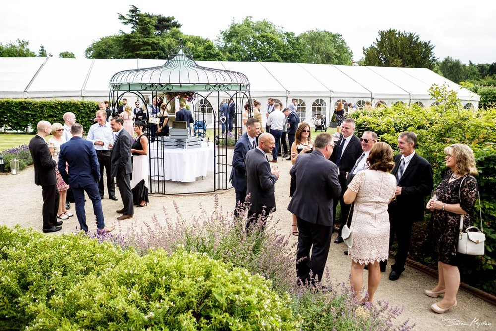 wedding guests at walled garden