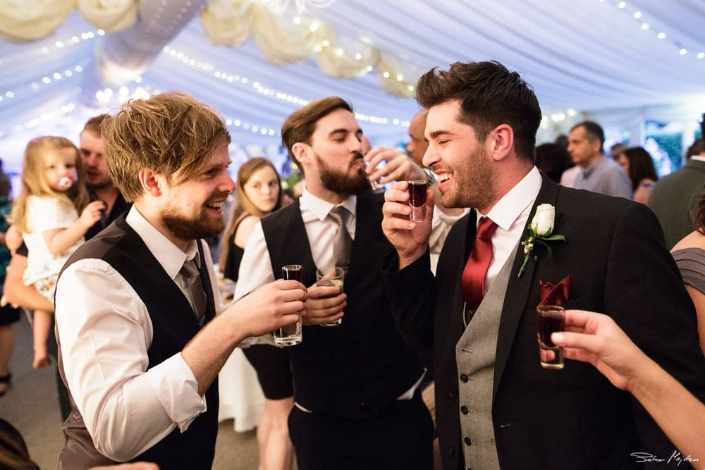 groom drinking shots with guests