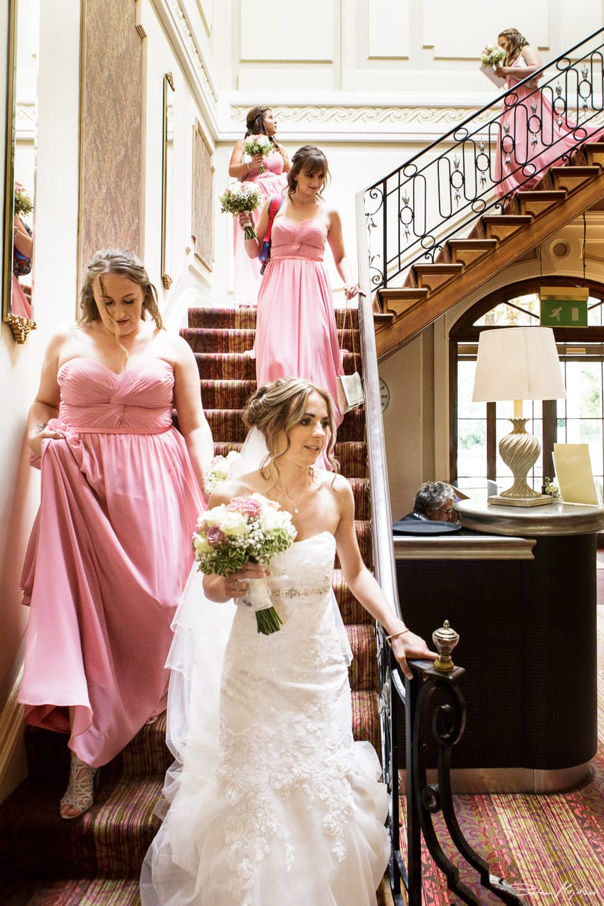 Bride and bridesmaids on the stairs