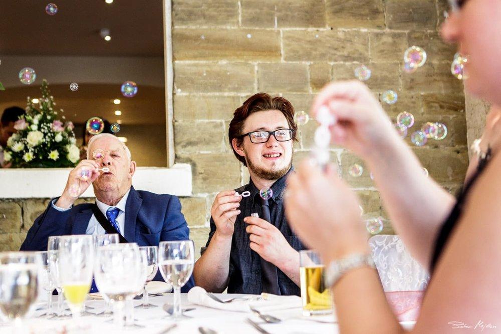 guests blowing bubbles