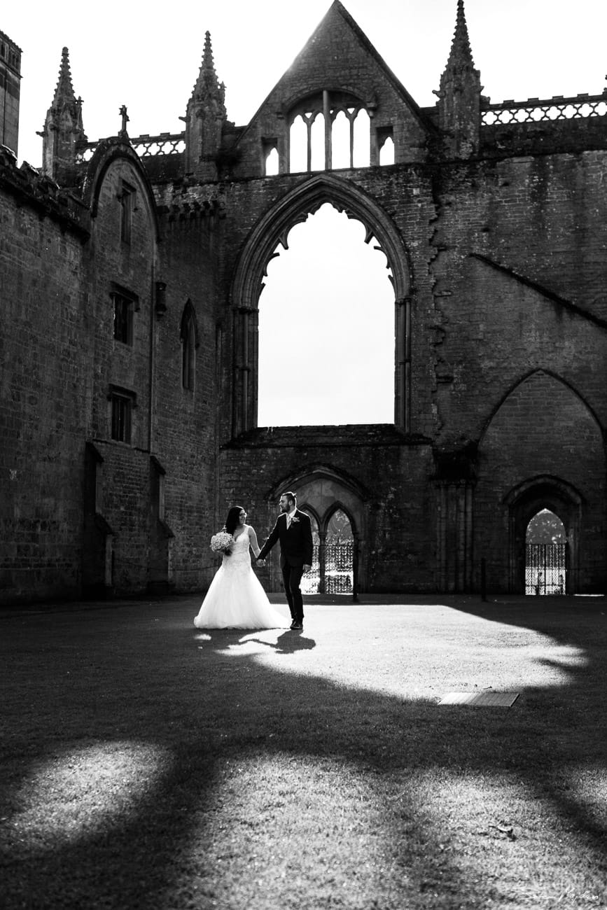 bride and groom walking around Newstead Abbey