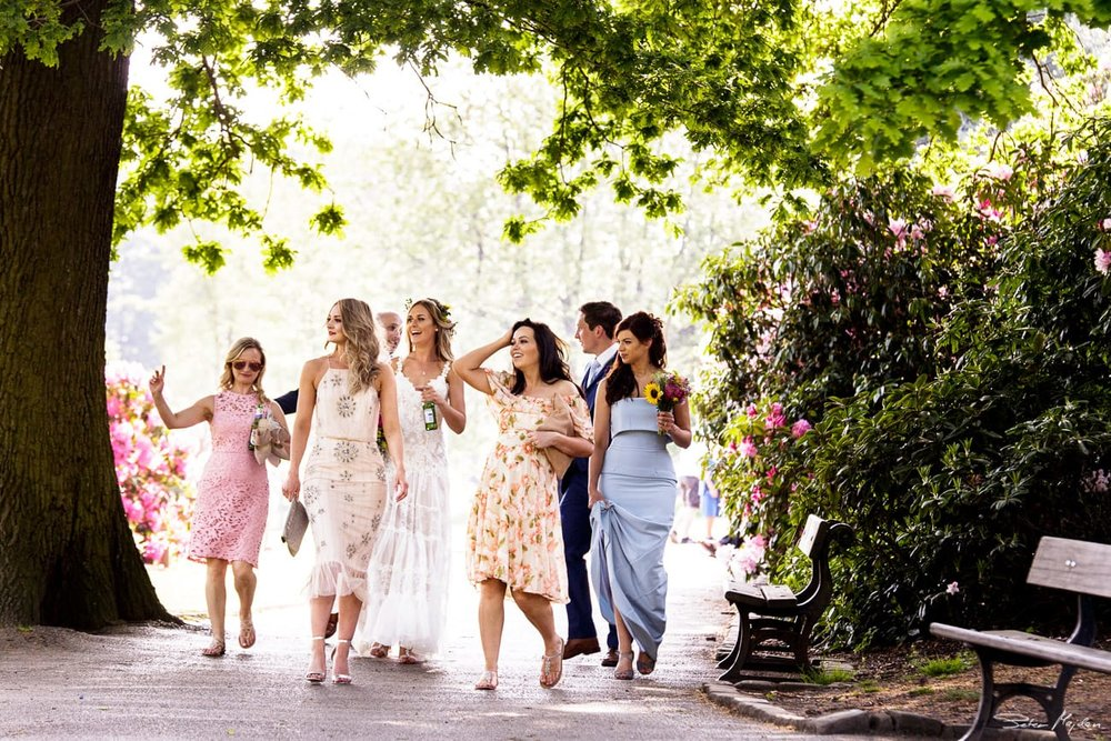 bride walking with guest to Walled Garden