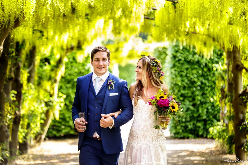 bride and groom walking in gardens