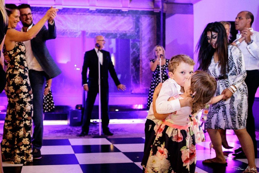 kids kissing on dancefloor