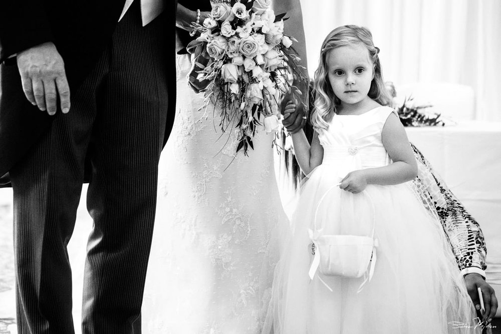flower girl with her parents
