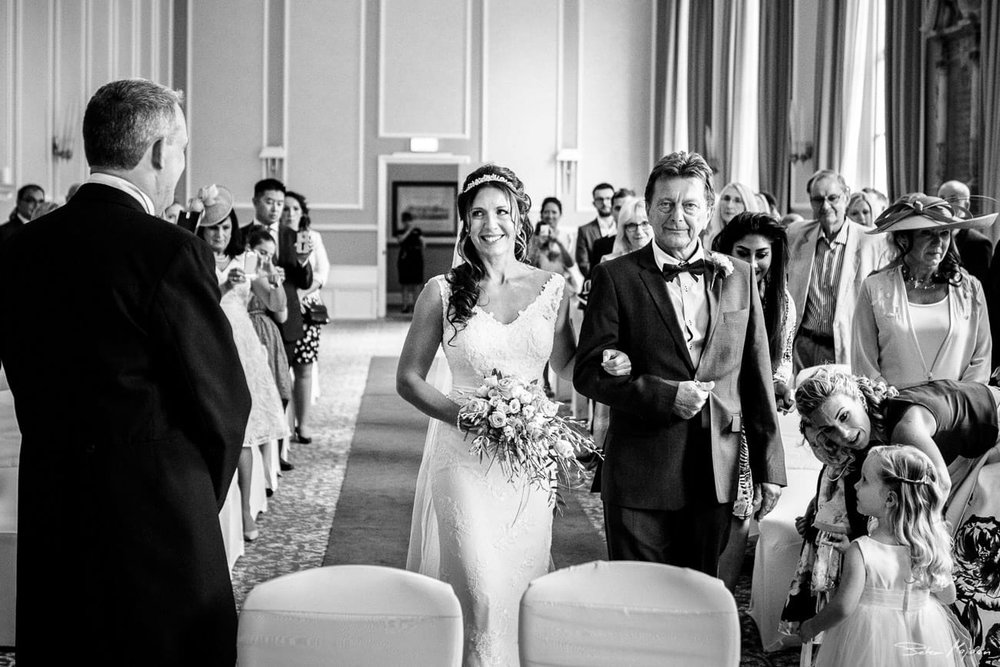 bride walking down the aisle at Beaumont Estate