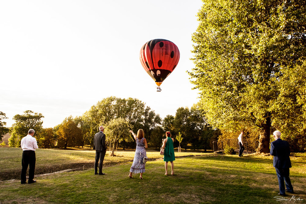 guest watching balloon outside Langar Hall
