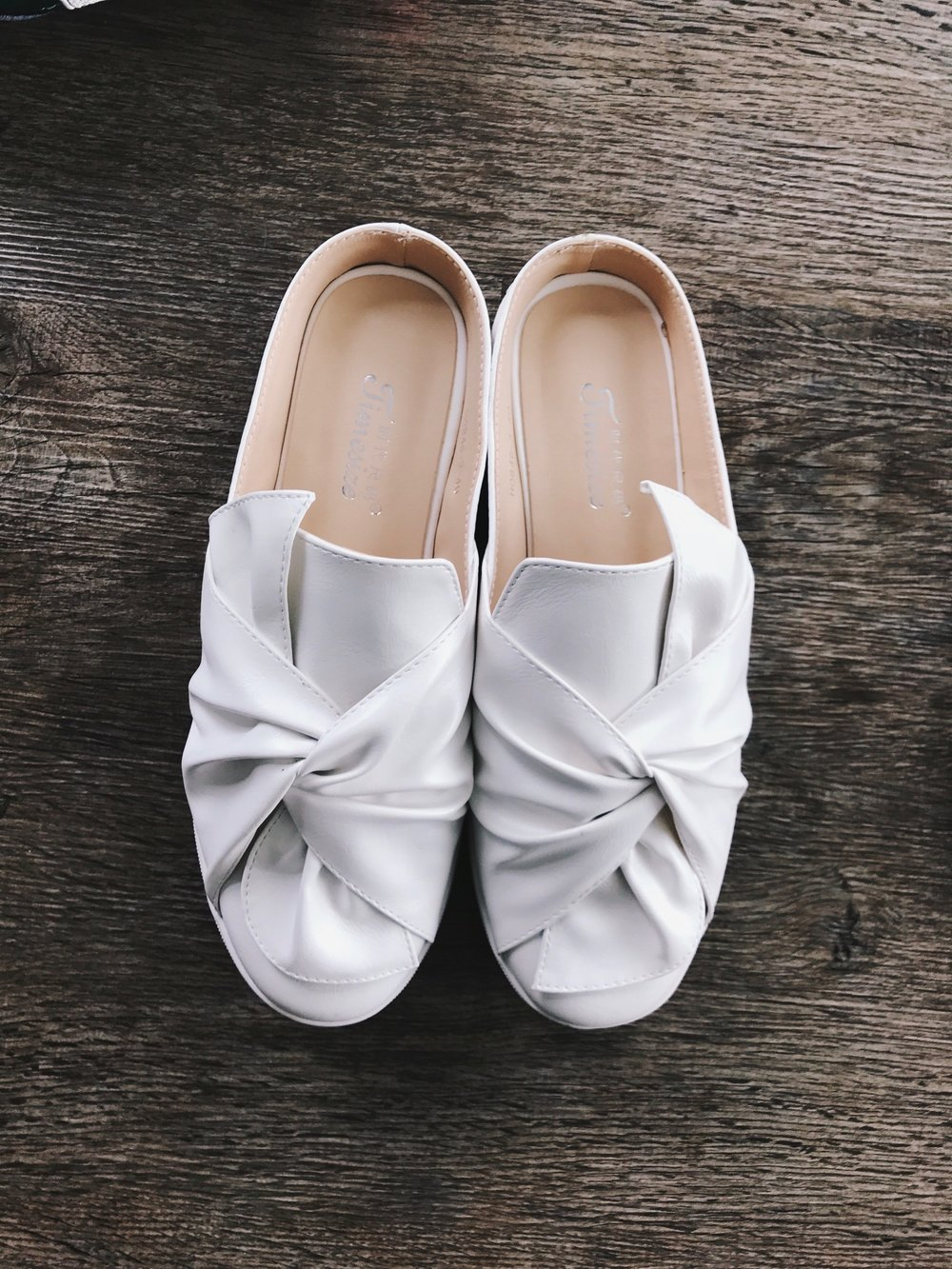 These  White Faux Leather Round Toe Slippers  ($32) are a bit unique as they're not a direct replica but rather a rendition of  Ports 1961 Knotted Sneakers  ($595). They are incredibly comfy with a bit of platform, and definitely my most adventurous pair of the set. I'm excited to match these with an all white outfit, featuring white denim, a white and black striped blouse, and geometric gold hoops.