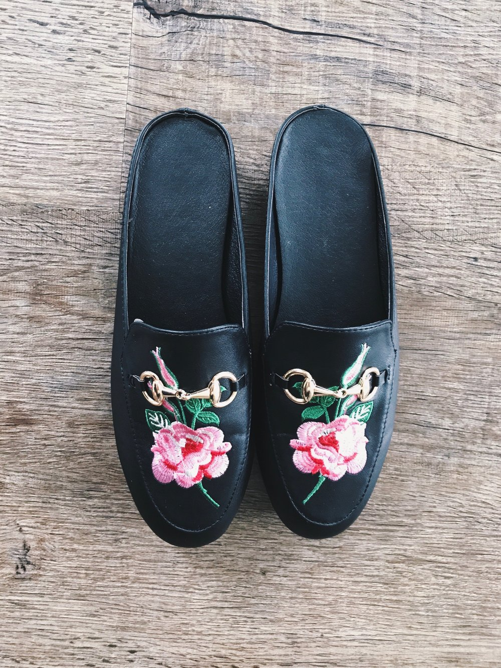 I'm sure I don't have to explain what these  Black Faux Leather Rose Embroidered Slip-on Shoes  ($32) are replicas of, but for those who haven't been on Instagram,  Gucci's Princetown Leather Loafers  ($795) are about as close to cult status now as anything. The leather quality is, as expected, the biggest disparity between these and the real thing, but the buckle and the embroidery are actually very spot-on. I'll wear these babies with some wide leg pants, a tank body suit, and a bomber for a hella comfortable weekend look.