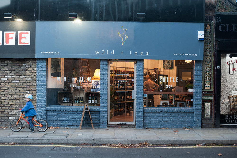 WE ARE A SHOP, A TASTING ROOM, AND YOU CAN ALSO STAY AND HAVE A DRINK AT OUR COSY WINDOW COUNTER WHILE WATCHING SE24 DO IT'S THING.