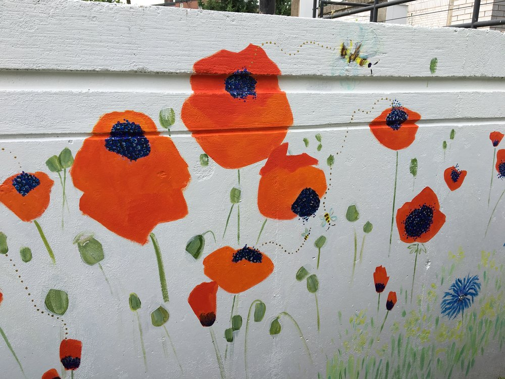 Poppies, bees and bachelor buttons