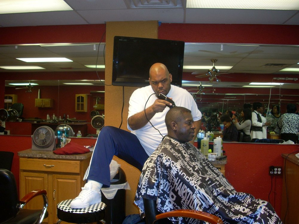 Marc The Barber cutting at Red's Creative Kuts (1611 Wadsworth Ave.