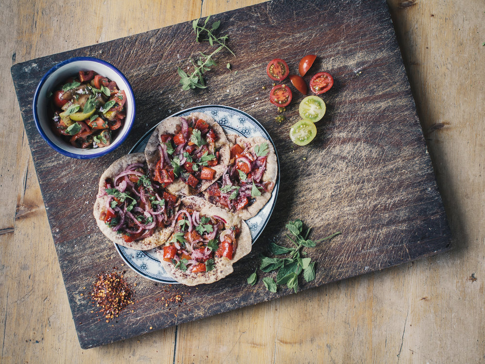 Anna Jones cooked some lovely vegetarian flatbreads with tomato salad.