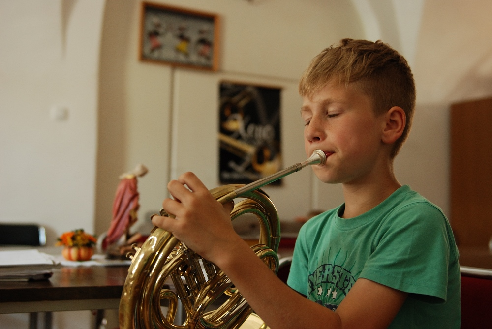 Little musicians - Children learning music at the Private Music School in monastery St. Peter and Paul in Ptuj, Slovenia.