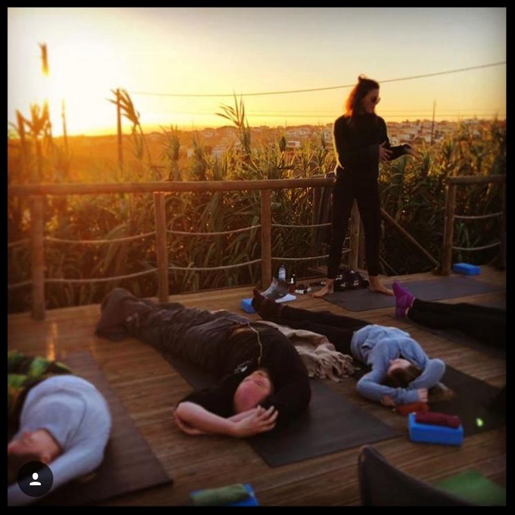 Faith teaching an outdoor Yin class in Portugal November 2017.