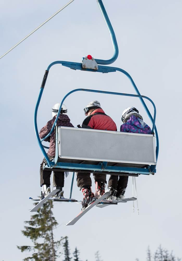 three-skiers-on-ski-lift-picjumbo-com crop.jpg