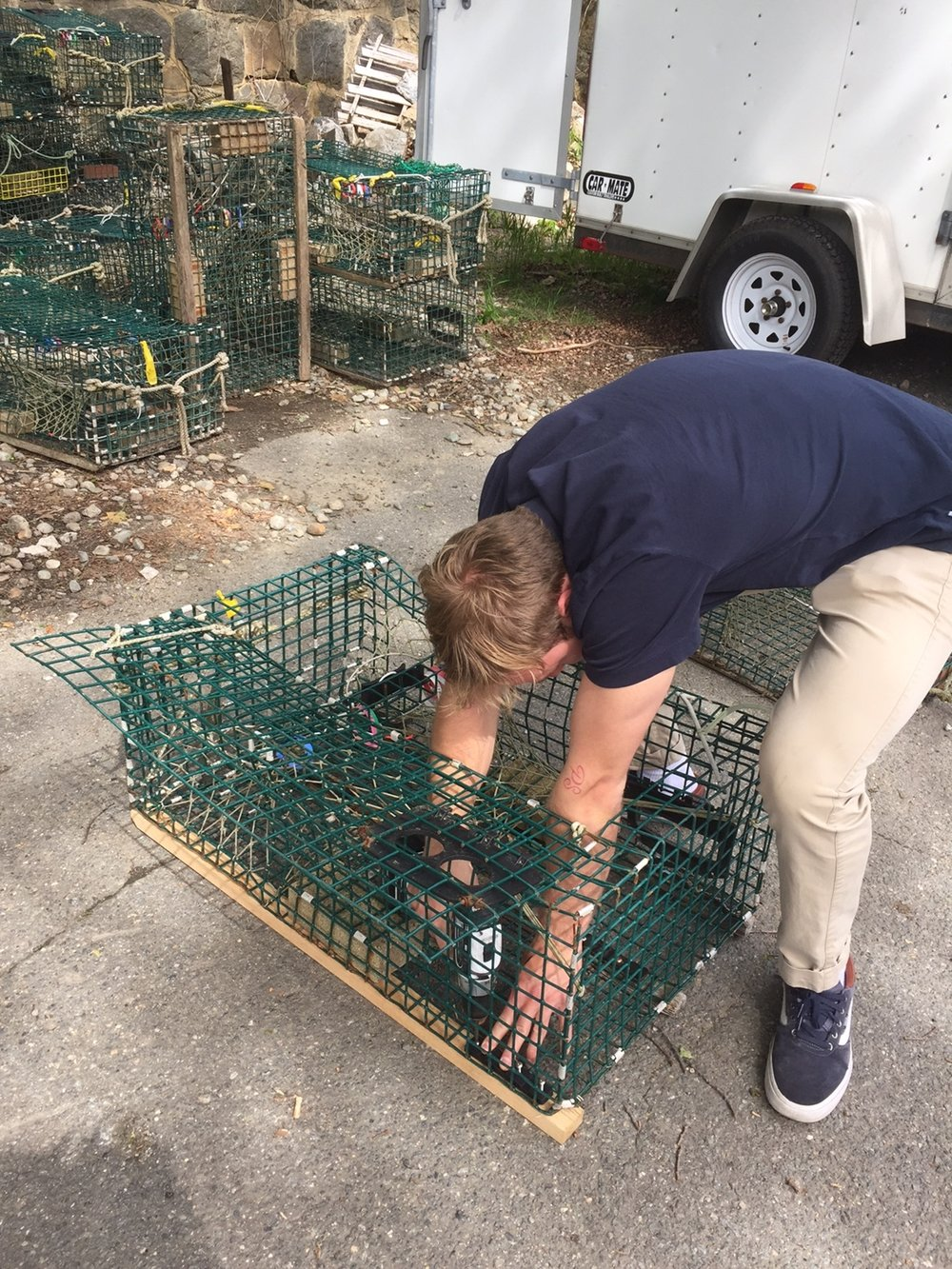 Intern Chilly assembles lobster traps in preparation for the SEA: Marine Life Exploration program; later he and Program Leader Skylar headed out on Chilly's boat to place the traps so that they could be pulled up during the program.