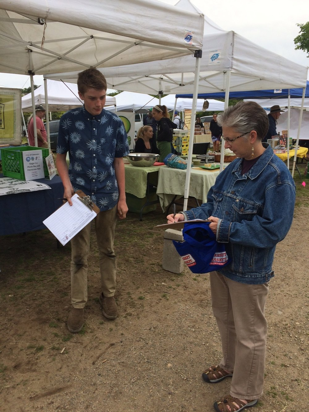 Intern Josh (above on right) and EJ (below on  right) represent Seaside Sustainability on behalf of the Plastic Bag & Polystyrene Ordinance Proposal, gathering petition signatures at the Gloucester Farmer's Market at Stage Fort Park.