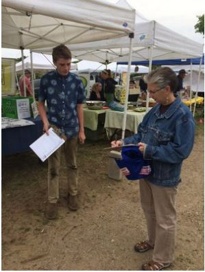 Intern Josh (above on right) and EJ (below right) represent Seaside Sustainability on behalf of the Plastic Bag & Polystyrene Ordinance Proposal, gathering petition signatures at the Gloucester Farmer's Market at Stage Fort Park.